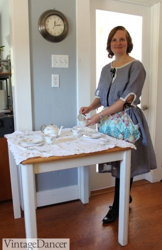 Serving tea in my 1920s house dress and my grandmothers scrap fabric tea apron