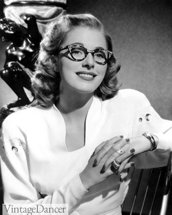 1940s- Actress Eleanor Parker wearing rhinestone studded eyeglasses