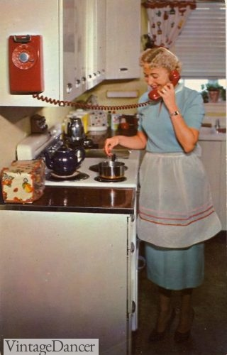 1950s house dress and white cotton apron.