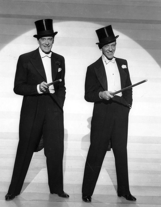 Jack Buchanan and Fred Astaire wearing formal white tie tuxedos