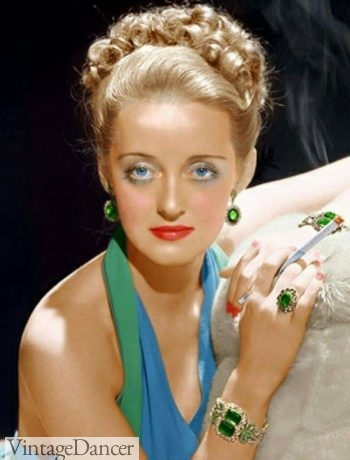 Full color jewelry was also common in evening wear in the late 1940s. Bette Davis.