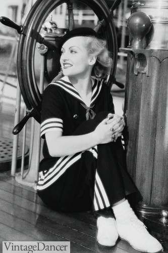 Carole Lombard, 1934, in a matching navy blue sailor shirt and striped pant.
