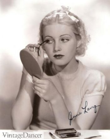 June Lang applying mascara 1930s