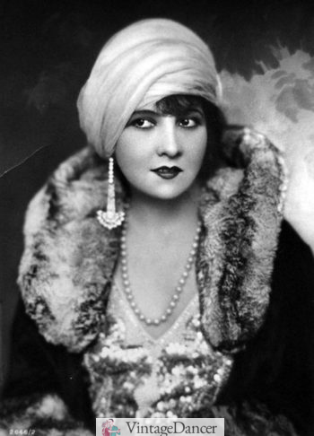 Lucy Doraine, Hungarian actress, wears a turban hat 1920s