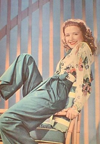 Priscilla Lane wearing her pants with a floral printed blouse