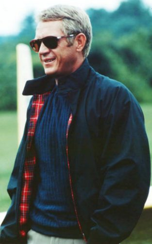 Steve McQueen with cable knit sweater, Harrington jacket, chinos and tortoiseshell sunglasses.