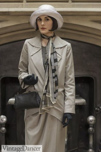 Mary Crawley in Downton Abbey wears a skinnny scarf knotted to the side of her neck