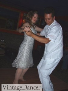 Swing dancing in all white- wide leg trousers and a cotton guayabera